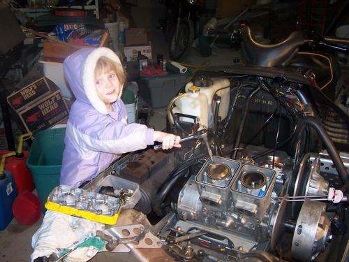 Heather helping assemble engine